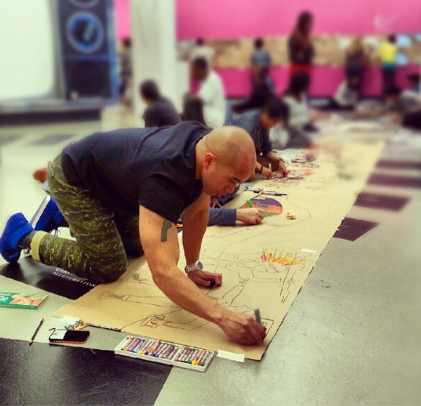 Rich Tu working on an exquisite corpse
